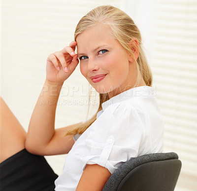Buy stock photo Portrait of an elegant young business woman at her workplace