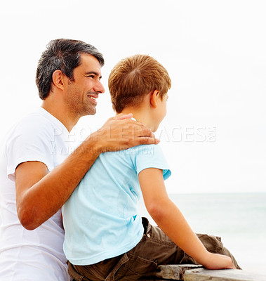Buy stock photo Happy father and son enjoying the beach view on a holiday