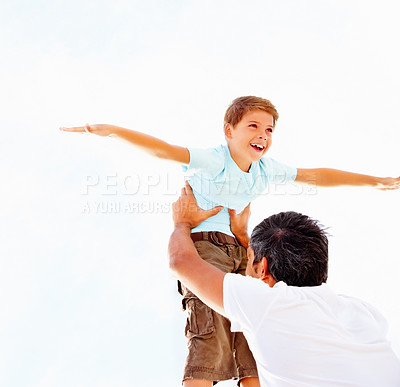 Buy stock photo Happy Adorable small boy being lifted up by his father, against the bright sky
