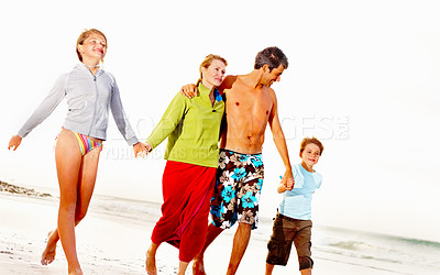 Buy stock photo Family taking a walk at the sea shore, holding hands