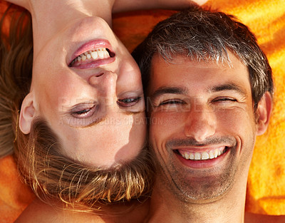 Buy stock photo Picnic - Closeup portrait of a happy couple lying on a towel