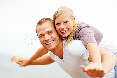 Buy stock photo Cute young couple in a playful mood, hands outstretched