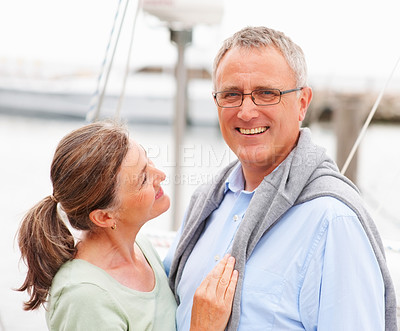 Buy stock photo Portrait of a happy old lady looking at her husband on sailboat