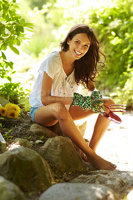 Buy stock photo Portrait of happy female gardener with gardening tools smiling outdoors