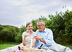 Happy senior couple having a glass of champagne while outdoors