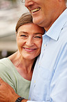 Cute mature woman being hugged by her husband