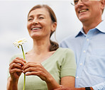 Lovely flower being held by an old couple