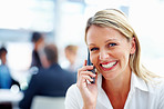 A lovely business woman laughing while communicating on mobile phone