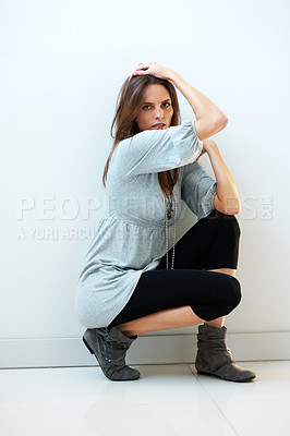 Buy stock photo Beautiful young female model posing against white