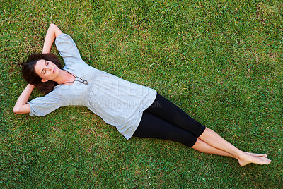 Buy stock photo Pretty young woman resting on grass