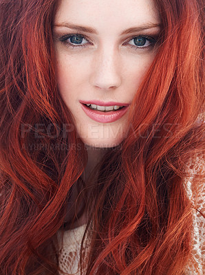 Buy stock photo A young redheaded woman smiling at the camera