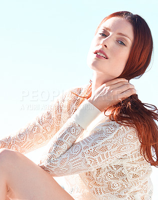 Buy stock photo A beautiful young redheaded woman posing outside