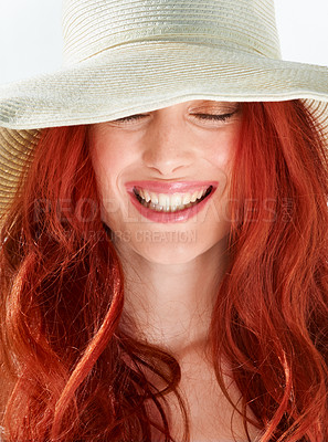 Buy stock photo A gorgeous young woman wearing a white sunhat