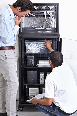 Buy stock photo A technician giving his client advice