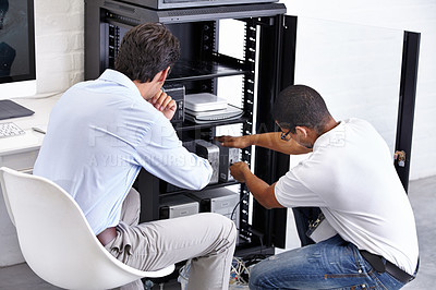 Buy stock photo A technician fixing his client's electronic device