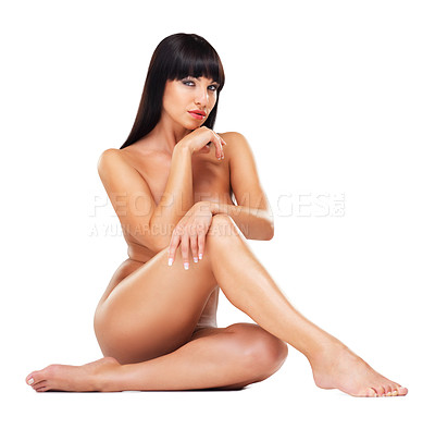 Buy stock photo Shot of a beautiful nude woman sitting against a white background
