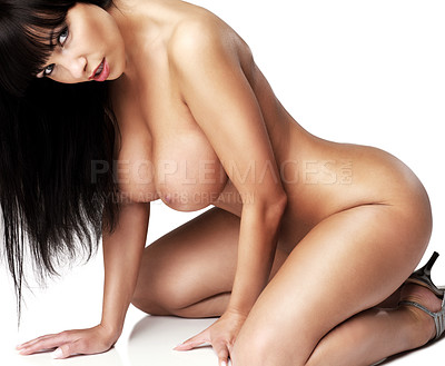 Buy stock photo A gorgeous young brunette posing nude while isolated on a white background