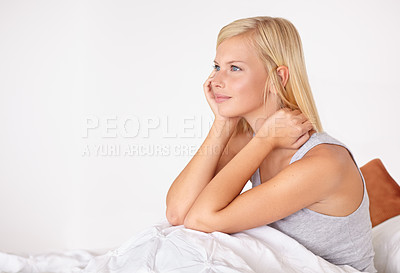 Buy stock photo A young woman looking thoughtful while sitting in bed
