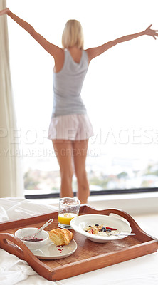 Buy stock photo A young woman starting her day off on a great note