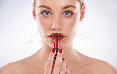 Buy stock photo Portrait of an attractive young woman wearing bright red lipstick and nail polish