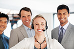 Female customer care representative smiling with office colleagues