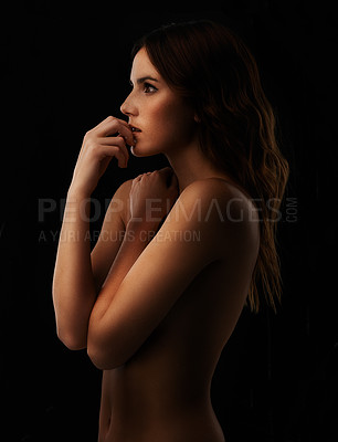 Buy stock photo A beautiful young woman standing against a black background
