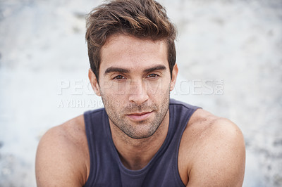 Buy stock photo A young man sitting outside