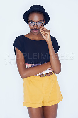 Buy stock photo A young woman posing against white
