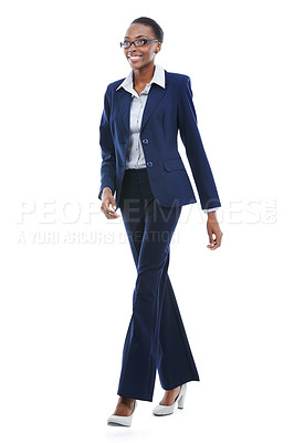 Buy stock photo Full length studio shot of an african american businesswoman walking happily isolated on white