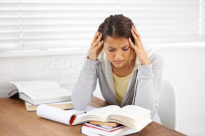 Buy stock photo Shot of an attractive young college student battling with her studies