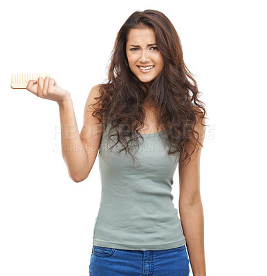 Buy stock photo Casual woman holding a comb and a looking at the camera