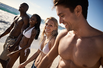 Buy stock photo Two young couples spending time at the beach together