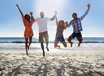 Buy stock photo Two young couples jumping and having fun together on the beach