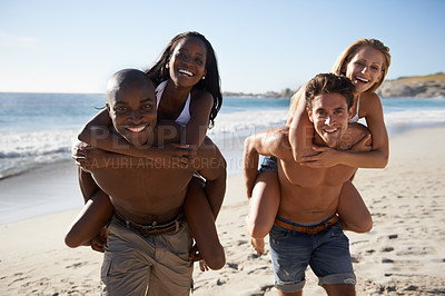 Buy stock photo Two young couples enjoying the sun on the beach together