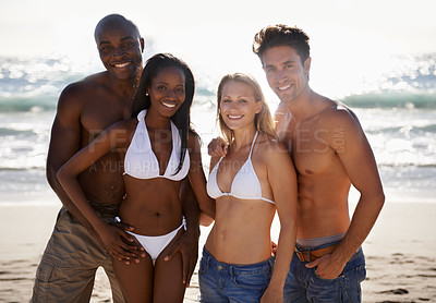 Buy stock photo Two young couples spending a day on the beach together