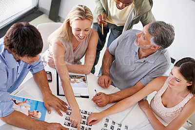 Buy stock photo A group of designers having a brainstorming session around a table