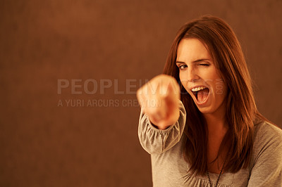 Buy stock photo Pretty excited young woman pointing at you against