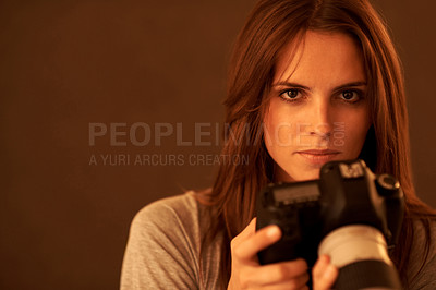 Buy stock photo Beautiful young lady with a camera against brown b