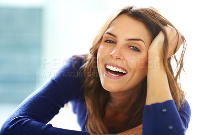Buy stock photo Beautiful young woman lying on floor laughing