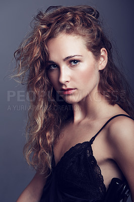 Buy stock photo An attractive young woman in lingerie looking at the camera