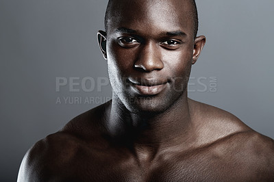 Buy stock photo Portrait of a handsome young african man in studio