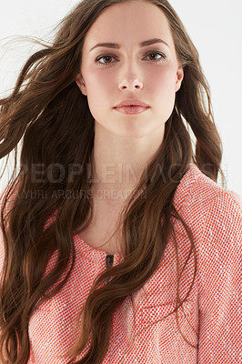 Buy stock photo Portrait of an attractive young woman looking at the camera