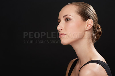 Buy stock photo Studio shot of an attractive young woman isolated on black