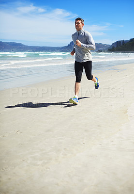 Buy stock photo Full length shot of a man jogging along the beach