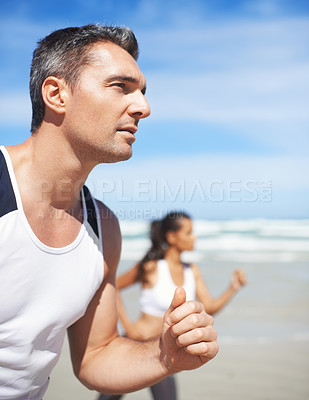 Buy stock photo Shot of two people running outdoors