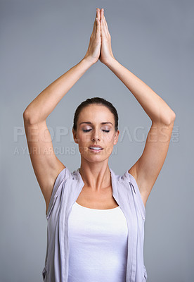 Buy stock photo An attractive young woman meditating