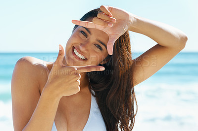 Buy stock photo A beautiful young woman in a swimsuit making a frame with her fingers
