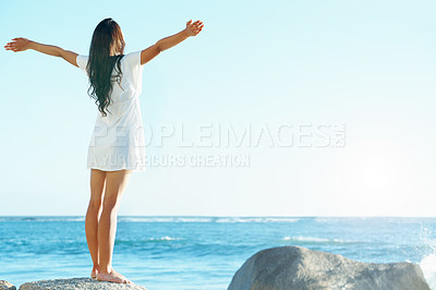 Buy stock photo Beautiful woman on the beach with her arms outstretched