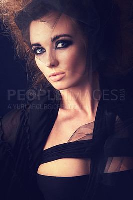 Buy stock photo A woman dressed in goth clothing and heavy eye make up looking at the camera