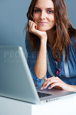 Buy stock photo Smiling young female using laptop
